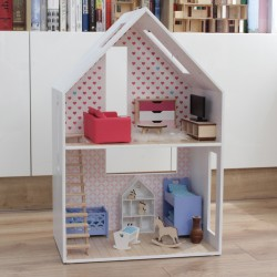 A small dollhouse with a...